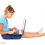 Young girl surfing the internet on a laptop