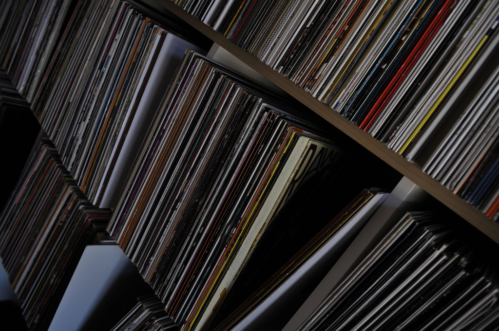 Vinyl records sitting on a shelf