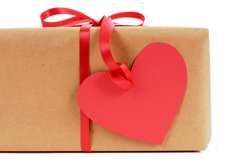 Brown paper package with heart shape tag