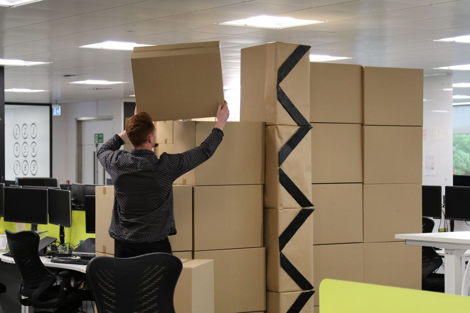 The boxes are put together to create the wall.