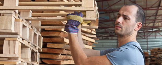 Man carefully arranging pallets