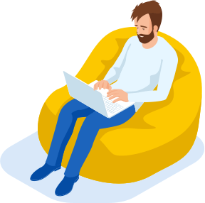 man sat in chair using a laptop